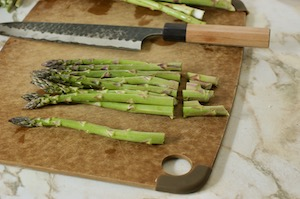 Trimming asparagus on a cutting board