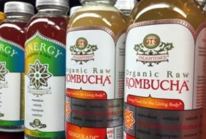 Kombucha bottles on shelf