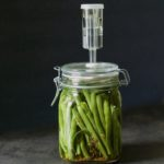 Lacto-fermented green beans in an airlock jar