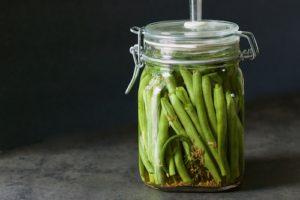 Lacto-fermented green beans in airlock jar
